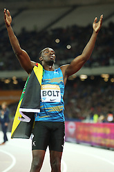 © Licensed to London News Pictures. 24/07/2015. London, UK. Jamaican sprinter Usain Bolt wins the 100m  in the Diamond League at the Olympic Stadium as part of the Sainsbury's Anniversary Games. Photo credit: LNP