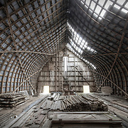 The sagging curves of the unique architecture of an old barn.