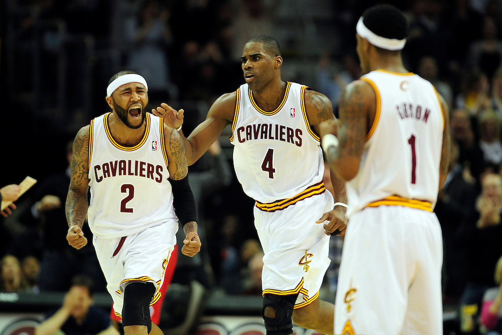 Feb. 11, 2011; Cleveland, OH, USA; Cleveland Cavaliers point guard Mo Williams (2) power forward Antawn Jamison (4) and point guard Daniel Gibson (1) celebrate after scoring during overtime against the Los Angeles Clippers at Quicken Loans Arena. The Cavaliers broke their loosing streak beating the Clipper 126-119 in overtime. Mandatory Credit: Jason Miller-US PRESSWIRE