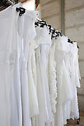 White wedding gowns in a charity shop