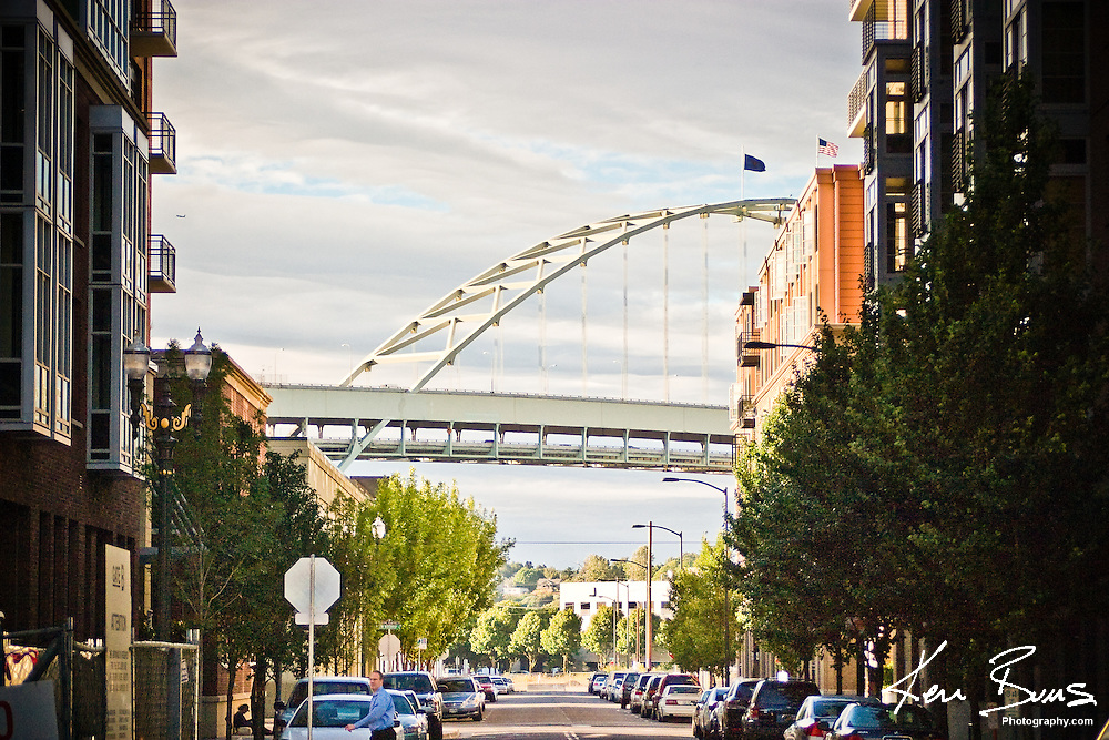 A picture looking North from the Pearl District with the Fremont Bridge in the background.The Fremont Bridge is a steel tied arch bridge over the Willamette River. The bridge was first opened on November 15, 1973.