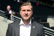 "MK Dons manager Karl Robinson wears a ""kick it out"" badge during the Sky Bet Championship match between Milton Keynes Dons and Nottingham Forest at stadium:mk, Milton Keynes, England on 7 May 2016. Photo by Dennis Goodwin."