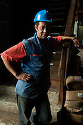 Mauritius. Rico works in the Lai Fat Fur Bros. & Co. China Town.