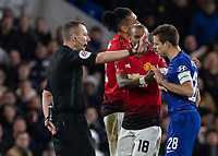 Football - 2018 / 2019 Emirates FA Cup - Fifth Round: Chelsea vs. Manchester United <br /> <br /> Tempers begin to fray as Cesar Azpilicueta (Chelsea FC)  and Ashley Young (Manchester United) speak to referee Kevin Friend at Stamford Bridge<br /> <br /> COLORSPORT/DANIEL BEARHAM