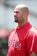 ANAHEIM, CA - JUNE 5:  Albert Pujols #5 of the Los Angeles Angels of Anaheim chats during batting practice before the game against the Chicago Cubs on Wednesday, June 5, 2013 at Angel Stadium in Anaheim, California. The Cubs won the game 8-6 in ten innings. (Photo by Paul Spinelli/MLB Photos via Getty Images) *** Local Caption *** Albert Pujols