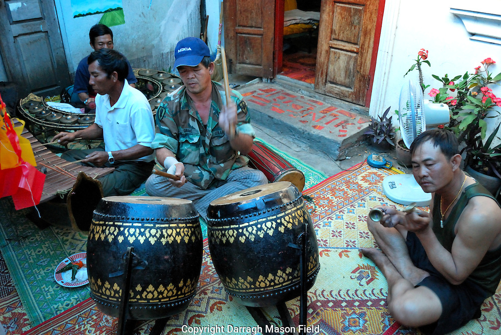 Musicians play music during a buddhist festival in Luang Prabang