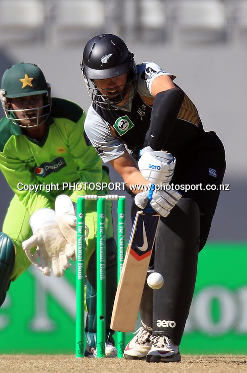 Peter McGlashan plays a defensive shot as Pakistan wicketkeeper Umar Akmal looks on. Twenty20 International Cricket match between The New Zealand Black Caps and Pakistan at Eden Park on Boxing Day, Sunday 26 December 2010. Photo: Andrew Cornaga/photosport.co.nz