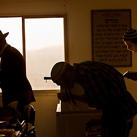 Israeli settlers pray in the synagogue of Havat Gilad.