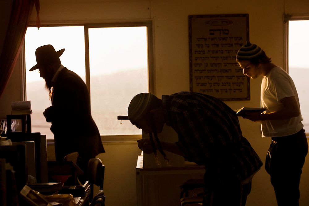 Israeli settlers pray in the synagogue of Havat Gilad.