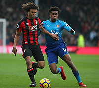 Football - 2017 / 2018 Premier League - AFC Bournemouth vs. Arsenal<br /> <br /> Alex Iwobi of Arsenal tries to knock Bournemouth's Nathan Ake off the ball at Dean Court (Vitality Stadium) Bournemouth <br /> <br /> COLORSPORT/SHAUN BOGGUST