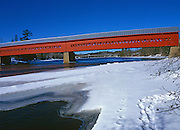 Red covered bridge over the Gatineau River<br /> Wakefield<br /> Quebec<br /> Canada