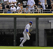 CHICAGO - JUNE 23:  Matt Kemp #27 of the Los Angeles Dodgers bobbles the ball but hangs on to make the catch on a fly ball hit by Chris Getz #17of the Chicago White Sox on June 23, 2009 at U.S. Cellular Field in Chicago, Illinois.  The Dodgers defeated the White Sox 5-2.  (Photo by Ron Vesely)