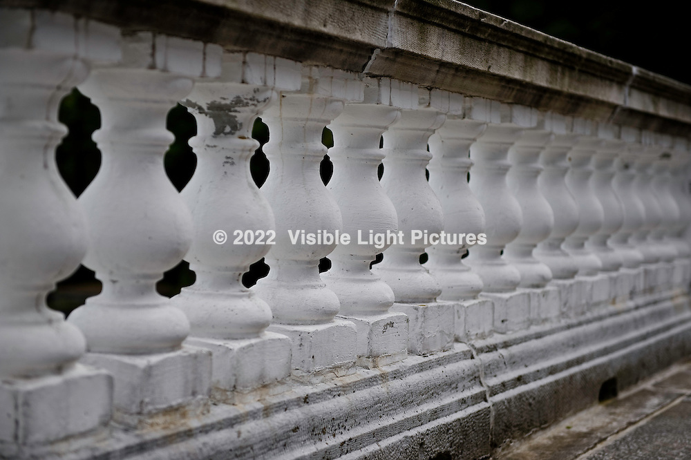 Marble balustrades on a stone porch railing.