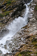 Close up of gushing water in a glacial waterfall. photographed at Sulzenaualm, Stubai, Tyrol, Austria