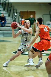 BLOOMINGTON, IL - December 15: Colin Bonnett and Tarren Hall during a college basketball game between the IWU Titans  and the Carroll Pioneers on December 15 2018 at Shirk Center in Bloomington, IL. (Photo by Alan Look)