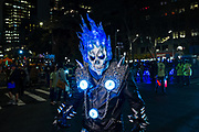 New York, NY - 31 October 2019. the annual Greenwich Village Halloween Parade along Manhattan's 6th Avenue. A man in an elaborate costume, wih a skull erupting in blue flames.