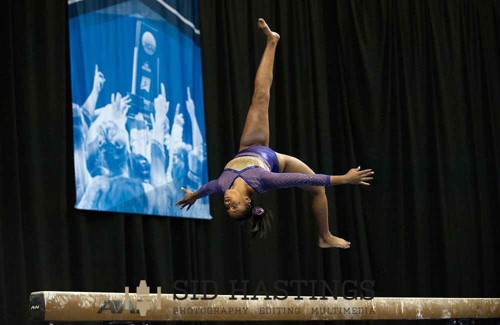20 APRIL 2018 -- ST. LOUIS -- LSU gymnast Kennedi Edney competes on the Balance Beam during the 2018 NCAA Women's Gymnastics Championship Semifinals in St. Louis Friday, April 20, 2018. LSU finished second in the semifinal, joining UCLA and Nebraska in advancing from the first semifinal into the Super Six championship round on Saturday.<br /> <br /> Photo &copy; copyright 2018 Sid Hastings.