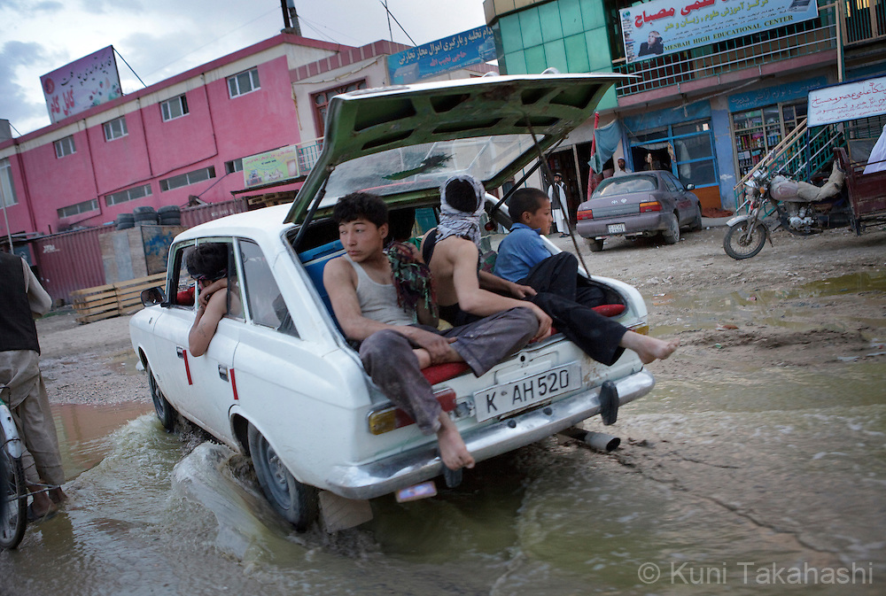 ( Mazar-i-Sharif, Afghanistan - May 11, 2012).Young laborers ride in trunk of a car in Mazar-i-Sharif in Afghanistan on May 11, 2012. .(Photo by Kuni Takahashi)