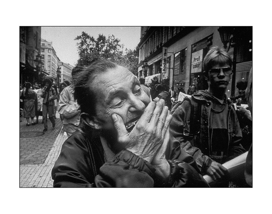 A street musician plays his harmonica on the Vaci Utca, in Budapest, Hungary. 1993 © Ed Hille