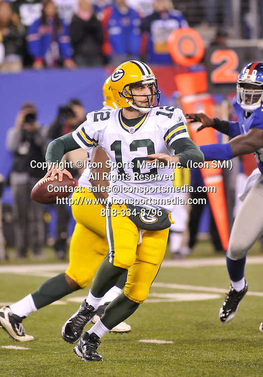 04 December 2011: Green Bay Packers  Aaron Rodgers #12 Quarterback under pressure during the New York Giants vs.Green bay Packers game at Metlife Stadium ,East Rutherford, New Jersey.Giants 35 Packers 38