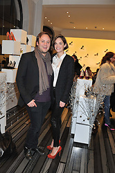 NICHOLAS KIRKWOOD and RUTH WILSON at a party to celebrate the launch of a limited edition shoe The Chambord in celebration of Nicholas Kirkwood's partnership with Chambord black raspberry liqueur, held at the Nicholas Kirkwood Boutique, 5 Mount Street, London on 12th December 2012.