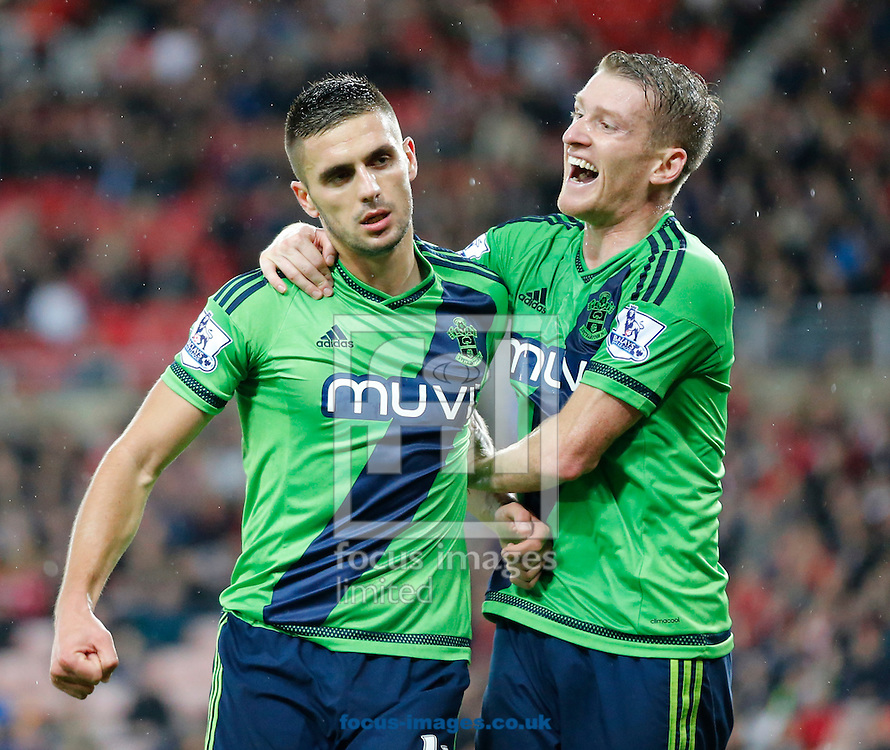 Dusan Tadic (l) of Southampton celebrates scoring the opening goal with Steven Davis during the Barclays Premier League match at the Stadium Of Light, Sunderland<br /> Picture by Simon Moore/Focus Images Ltd 07807 671782<br /> 07/11/2015