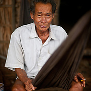 A Cambodian man relaxes in a hammock.