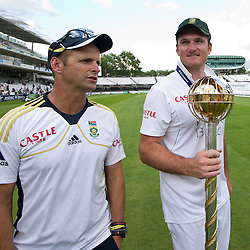20/08/2012 London, England. South Africa manager Gary Kirsten and South Africa's Graeme Smith with the Mace for becoming the No1 test team in the world after winning the third Investec cricket international test match between England and South Africa, played at the Lords Cricket Ground: Mandatory credit: Mitchell Gunn
