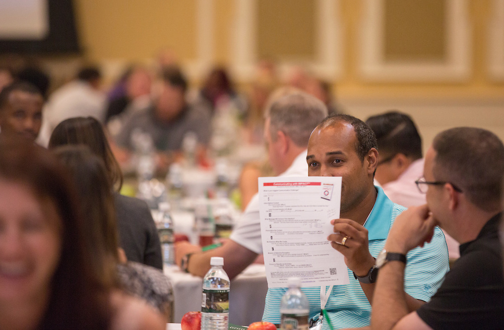 Irving Williams, of Englewood, Ohio, holds up his idea page for others at his table to see during Patrick Donadio's presentation at the Leadership Development Program event in Baker Ballroom on August 26, 2016. Photo by Emily Matthews