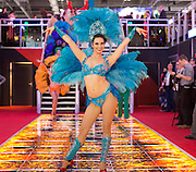 UNITED KINGDOM, London: 02 February 2016 A promotion girl performs for Euro Games Technology at this years ICE Totally Gaming Convention held at the Excel Arena, East London. The three day event is the world's premier international expo for gaming and gambling professionals. Rick Findler / Story Picture Agency