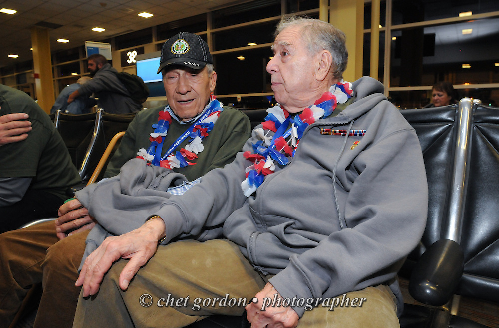 WWII Veterans and their escorts onboard the Hudson Valley Honor Flight #10 depart Reagan National Airport in Arlington, VA on Saturday, November 7, 2015. Sixty-four veterans from the Westchester County (NY) area toured the WWII and Marine Corps War Memorials, as well as Arlington National Cemetery. Hudson Valley Honor Flight is a chapter of the Honor Flight Network, which provides free flights for WWII Veterans and tours of the WWII Memorial constructed in their honor, and other sites in the nation's capital.  © Chet Gordon / Hudson Valley Honor Flight