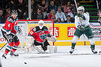 KELOWNA, CANADA - DECEMBER 6: Jordon Cooke #30 of the Kelowna Rockets keeps his eye on the puck against the Everett Silvertips on December 6, 2013 at Prospera Place in Kelowna, British Columbia, Canada.   (Photo by Marissa Baecker/Shoot the Breeze)  ***  Local Caption  ***