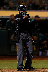 OAKLAND, CA - SEPTEMBER 16: MLB umpire CB Bucknor #54 calls a strike during the ninth inning between the Oakland Athletics and the Kansas City Royals at the RingCentral Coliseum on September 16, 2019 in Oakland, California. The Kansas City Royals defeated the Oakland Athletics 6-5. (Photo by Jason O. Watson/Getty Images) *** Local Caption *** CB Bucknor
