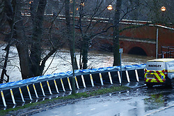 © Licensed to London News Pictures. 21/12/2019. Leatherhead, UK. Environment Agency flood defences have been installed in Leatherhead, Surrey after fears that the river Mole would flood parts of the high street and surrounding houses. River levels remain high after heavy overnight rain in the south. Photo credit: Peter Macdiarmid/LNP