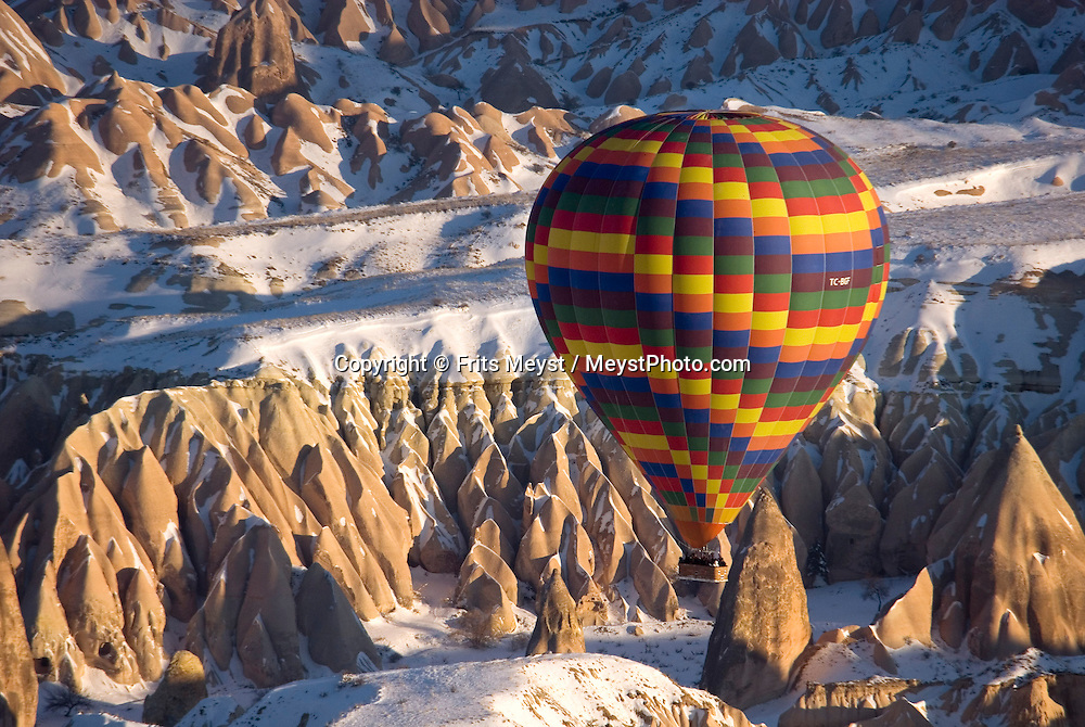 Goreme, Nevsehir, Cappadocia, Turkey, January 2008. Balloons fly over Rose and Red valleys. With a hot air balloon of Kapadokya Balloons we glide over the valleys of Goreme National Park. A fresh pack of snow has turned the winter landscape into an even bigger fairy tale. Photo by Frits Meyst/Adventure4ever.com