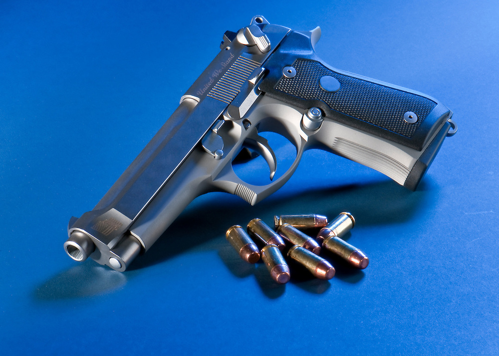 Close up view of bullets and automatic gun.