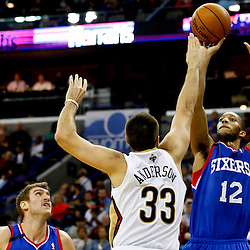Nov 16, 2013; New Orleans, LA, USA; Philadelphia 76ers small forward Evan Turner (12) shoots over New Orleans Pelicans power forward Ryan Anderson (33) during the first half of a game at New Orleans Arena. Mandatory Credit: Derick E. Hingle-USA TODAY Sports