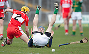 Meath v Derry NHL, Division 3A at Pairc Tailteann, Navan, 27/3/10.Ups-a-daisy, as Meaths Mark Mullally goes down in the second half, closely watched by Michael Foley (Derry).Photo: David Mullen /www.cyberimages.net