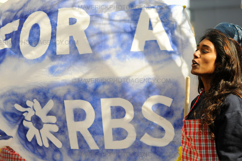 Shareholders of the Royal Bank of Scotland arrive at the Edinburgh International Conference centre to attend the companies annual general meeting on April 3rd, 2009 in Edinburgh, Scotland.  Shareholders are expected to express their anger at its past and present directors.  Pictured a group of protesters outside the conference center.