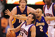 May 25, 2010; Phoenix, AZ, USA; Phoenix Suns guard Steve Nash (13) is fouled by Los Angeles Lakers guard Derek Fisher (2) during the second half in game four of the western conference finals in the 2010 NBA Playoffs at US Airways Center.  The Suns defeated the Lakers 115 - 106.  Mandatory Credit: Jennifer Stewart-US PRESSWIRE