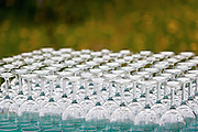 Rows of wine glasses outside.