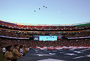 A large American flag is displayed on the field as United States military jets do a flyover before the Washington Redskins 2016 NFL week 1 regular season football game against the Pittsburgh Steelers on Monday, Sept. 12, 2016 in Landover, Md. The Steelers won the game 38-16. (©Paul Anthony Spinelli)
