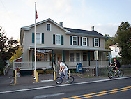 TOWNBY18P<br /> Two boys who declined to identify themselves ride bicycles past the Wycombe Post Office Thursday October 8, 2015 in Wrightstown Pennsylvania. Wrightstown is a Bucks County community that is not as much of a destination as the towns around it. (William Thomas Cain/For The Inquirer)