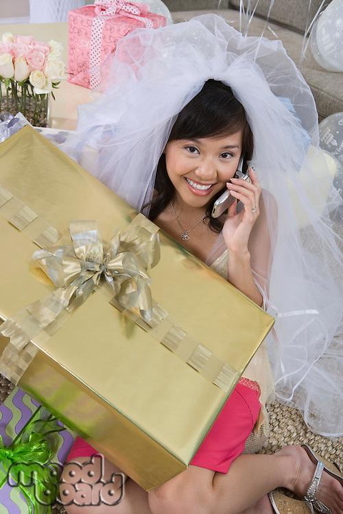 Bride using mobile phone at bridal shower