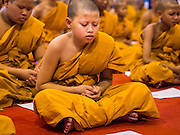 02 APRIL 2015 - CHIANG MAI, CHIANG MAI, THAILAND: Buddhist novices pray in Wat Chedi Luang in Chiang Mai during a prayer service to mark the 60th Birthday celebrations for HRH Princess Maha Chakri Sirindhorn, daughter of Bhumibol Adulyadej, the King of Thailand, and his wife, Queen Sirikit. The Princess is revered by most Thais and her birthday is celebrated throughout Thailand.    PHOTO BY JACK KURTZ