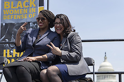 April 30, 2019 - Washington, District of Columbia, U.S. - United States Representative Ayanna Pressley, Democrat of Massachusetts, left, and Representative Rashida Tlaib, Democrat of Michigan, pose for a photo during a press event in front of the United States Capitol in Washington, D.C. on April 30, 2019. Several members of Congress attended the event and spoke out against recent tweets by President Donald Trump that attacked Rep. Ilhan Omar. Credit: Alex Edelman / CNP (Credit Image: © Alex Edelman/CNP via ZUMA Wire)