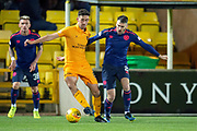 Shaun Byrne (#6) of Livingston FC shields the ball from Michael Smith (#2) of Heart of Midlothian during the Ladbrokes Scottish Premiership match between Livingston FC and Heart of Midlothian FC at the Tony Macaroni Arena, Livingston, Scotland on 14 December 2018.