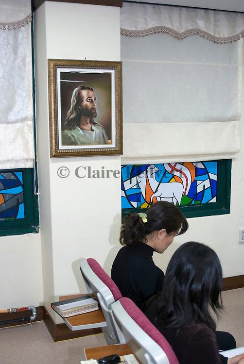 North Korean refugees praying in Durihana mission's church.