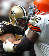 MORNING JOURNAL/DAVID RICHARD.New Orleans center Jeff Faine, left, gets locked up the Ted Washington of Cleveland.