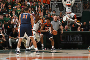 February 13, 2018: De'Andre Hunter #12 of Virginia in action during the NCAA basketball game between the Miami Hurricanes and the Virginia Cavaliers in Coral Gables, Florida. The Cavaliers defeated the 'Canes 59-50.